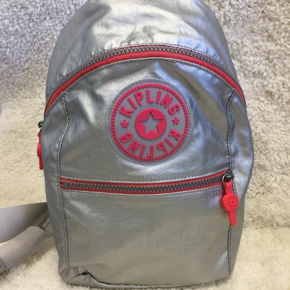 9f1e3bc160 Kipling Bags | Nwt Bente Sling Backpack In Platinum | Poshmark